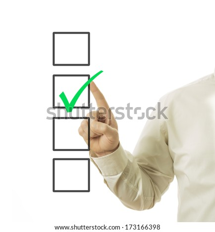 businessman hand and check box with green mark in it  - stock photo