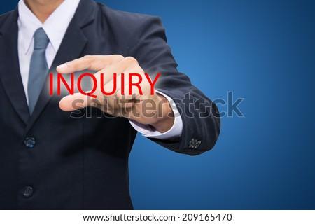 Businessman hand and INQUIRY - stock photo