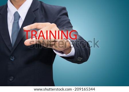Businessman hand and TRAINING - stock photo