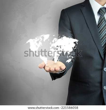 Businessman hand carrying world map  - worldwide business,   world domination concepts etc. - stock photo