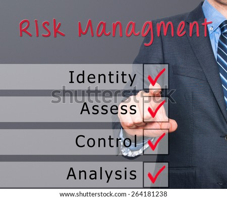 Businessman hand checking the checklist boxes risk management identity assess control analysis by pen on transparent glass. Isolated on grey background. Stock Iamge - stock photo