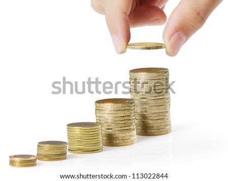 businessman hand coins in finger and row stacks them isolated on white - stock photo