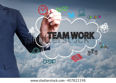 businessman hand draw cloud , icon cartoon with TEAM WORK  text , business online , business concept ,business idea , analysis concept - stock photo