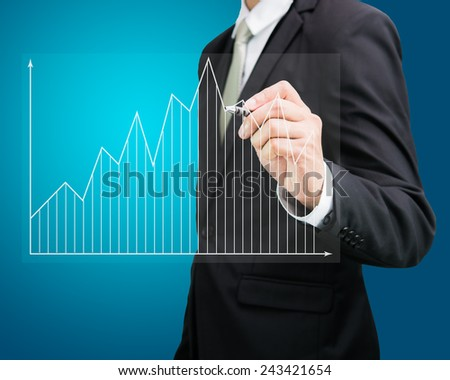 Businessman hand drawing a graph Isolated on blue background - stock photo