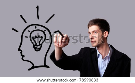 Businessman hand drawing and idea for making money on the whiteboard