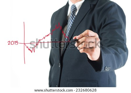 Businessman hand drawing business charts and graphs 2015 new year in a whiteboard, isolated on white background - stock photo