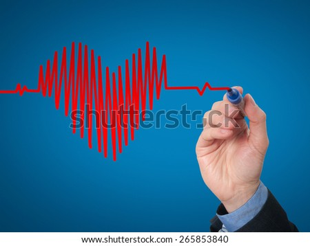 Businessman hand drawing chart heartbeat. Isolated on blue background. Stock Image