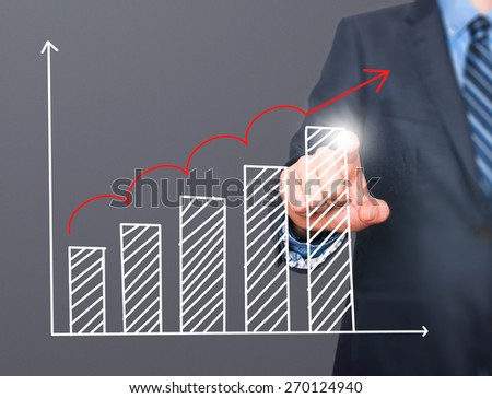 Businessman hand drawing growth graph on visual screen. Isolated on grey. Man finger on chart. Business, internet, technology concept. Stock Image - stock photo