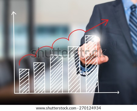 Businessman hand drawing growth graph on visual screen. Isolated on office. Man finger on chart. Business, internet, technology concept. Stock Image - stock photo