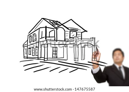 businessman hand drawing house on whitebord