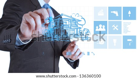 businessman hand drawing house with modern computer interface as concept