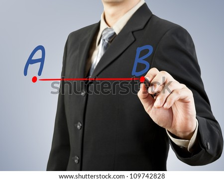 businessman hand drawing line from point A to B - stock photo