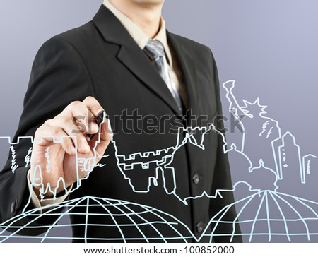businessman hand drawing the dream travel around the world - stock photo