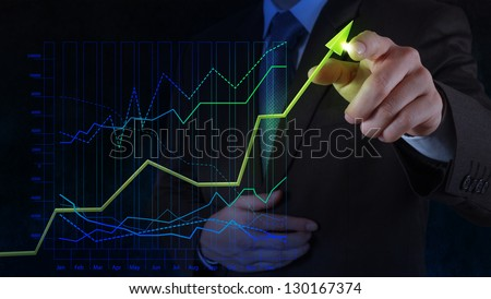 businessman hand drawing virtual chart business on touch screen computer as concept - stock photo
