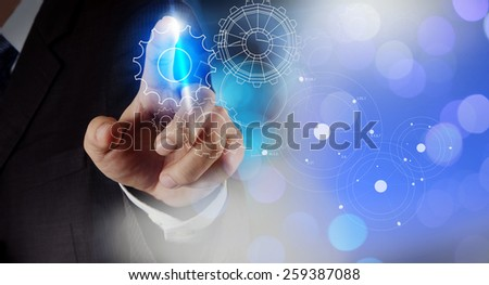 businessman hand draws gear to success concept with exposure bokeh - stock photo