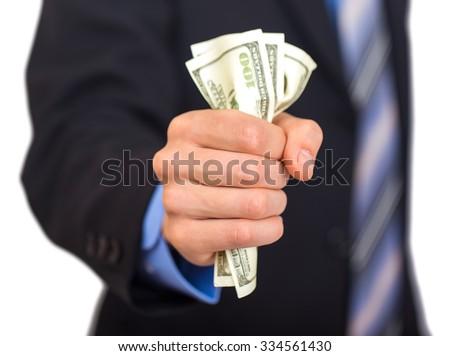 Businessman hand grabbing money on white background - stock photo