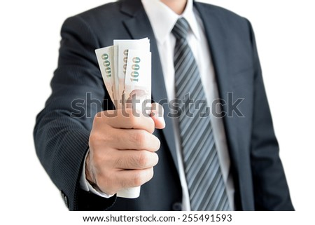 Businessman hand grabbing money, Thai Baht (THB) - isolated on white background