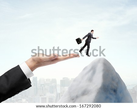 businessman hand halped to jump to man - stock photo