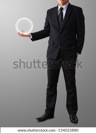 businessman Hand holding a Glass Ball - stock photo