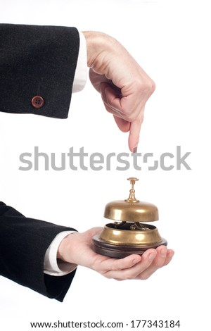 businessman hand holding a service bell on white background