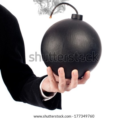 businessman hand holding an old-fashioned bomb on a white background - stock photo