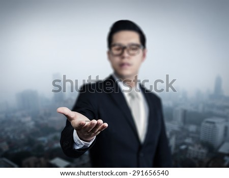 Businessman hand holding blank, new business in the city collection, studio shot - stock photo
