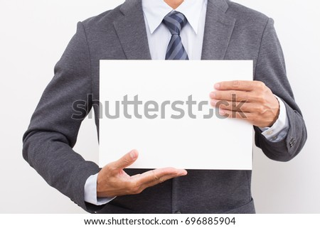 Businessman hand holding blank white board.