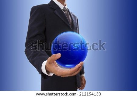 Businessman hand holding blue crystal Ball  - stock photo