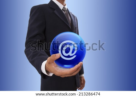 Businessman hand holding blue crystal ball with email sign. - stock photo