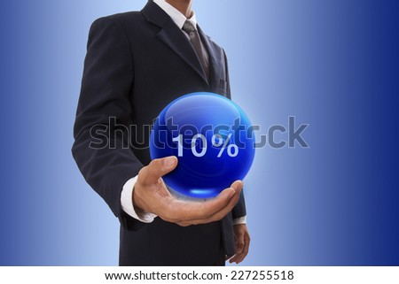 Businessman hand holding blue crystal ball with 10 percent discount. - stock photo