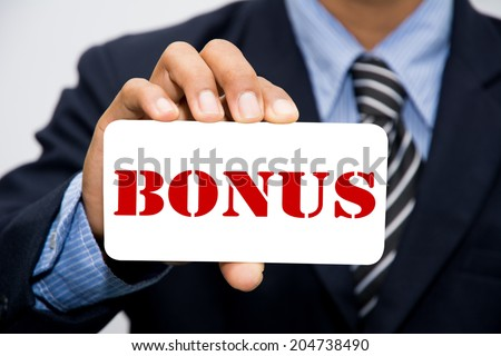 Businessman hand holding bonus concept  - stock photo