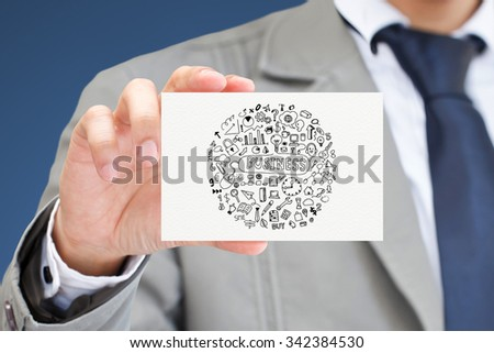 Businessman hand holding card with Business doodles concept. - stock photo