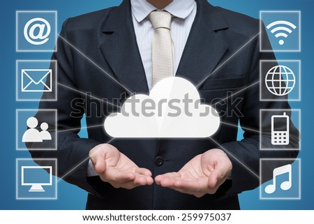 Businessman hand holding cloud computing network isolated on blue background