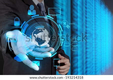 businessman hand holding cloud network icon on touch screen computer as Internet security online business concept  - stock photo