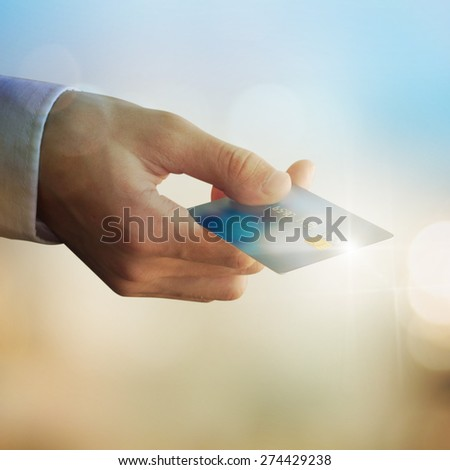 Businessman Hand holding credit card - stock photo