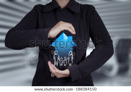 businessman hand holding 3d house with family icon as insurance concept  - stock photo
