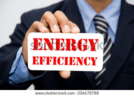 Businessman hand holding ENERGY EFFICIENCY concept  - stock photo