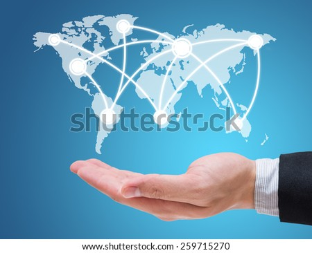 Businessman hand holding globe map isolated on blue background