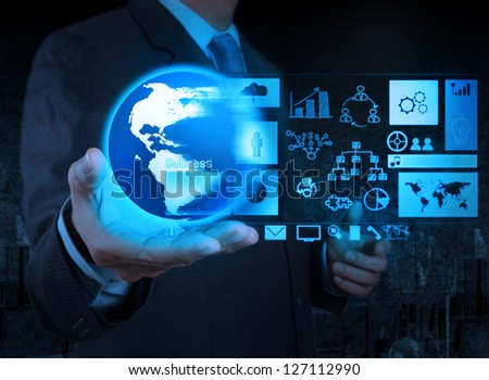 businessman hand holding globe with business diagram on touch screen interface