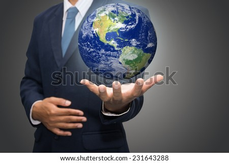 "Businessman hand holding globe with Earth in the background ""Elements of this image furnished by NASA""."