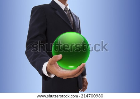 Businessman hand holding green crystal ball. - stock photo