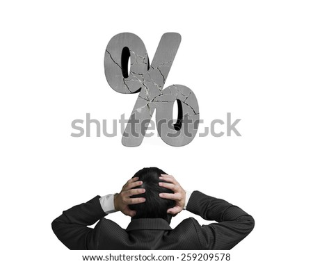 Businessman hand holding head with cracked percentage sign isolated on white background - stock photo