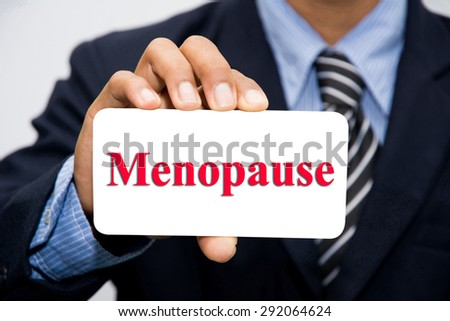 Businessman hand holding Menopause concept - stock photo