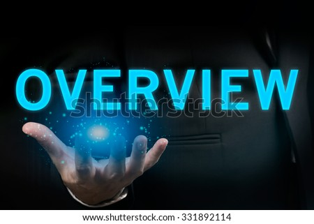 Businessman hand Holding OVERVIEW Word - stock photo