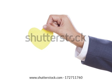 Businessman hand holding paper heart, isolated on white background. with using path  - stock photo