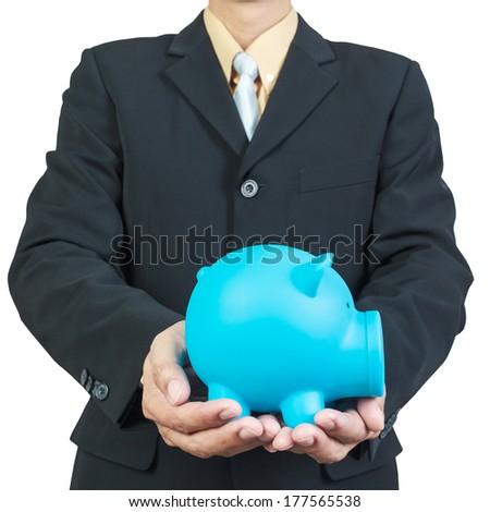 Businessman hand holding piggy bank on white background - stock photo