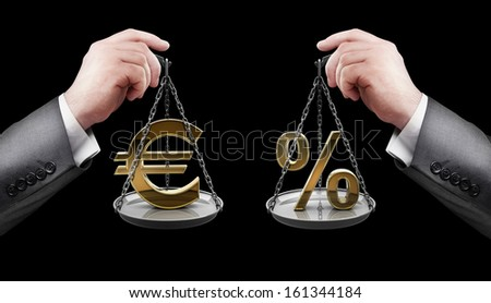 businessman hand holding Scale with procent symbols and symbols of currencies Euro  - stock photo