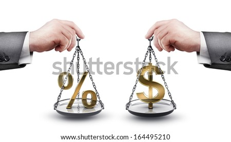businessman hand holding Scale with procent symbols and symbols of currencies US dollar  isolated on white background High resolution  - stock photo
