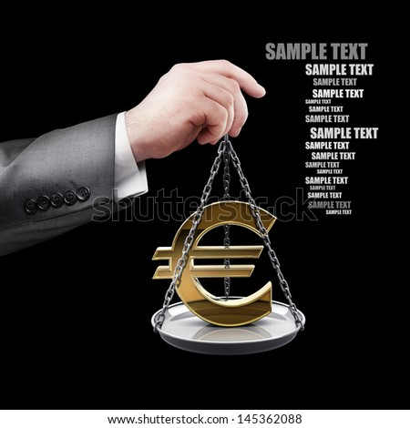 businessman hand holding Scale with symbols of currencies Euro isolated on black background  - stock photo