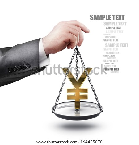 businessman hand holding Scale with symbols of currencies Yen  isolated on white background High resolution  - stock photo